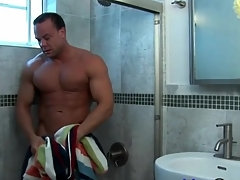 Smooth muscle man takes a shower and strokes