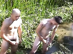 Four beautiful and horny soldiers masturbate together in the outdoors